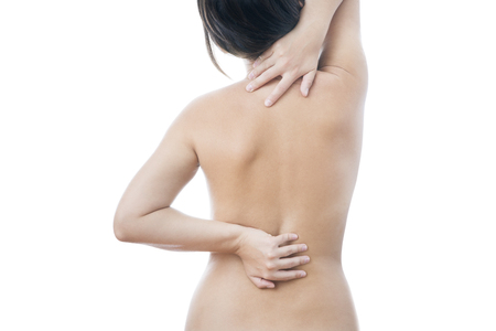 Pain in back of women. Caring for the female body. photo