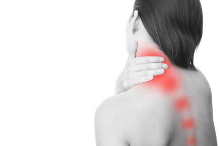 首の痛みの女性の。首に触れます。