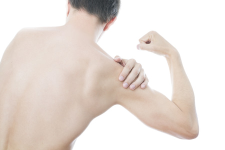 Hands on a mens shoulder. Pain in the muscles. photo