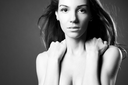 Beautiful woman in studio. Black and white photography photo