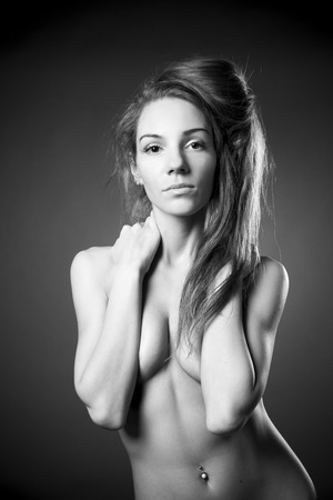 Young naked girl in studio. Black and white photography photo