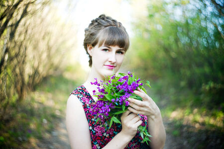 Beautiful young woman with flowers. photo