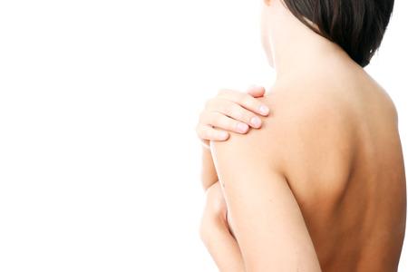 Hände auf eine Frau Schulter. Schmerzen in den Muskeln. Standard-Bild