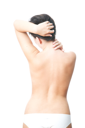 Pain in the back of women. Touching the neck. photo