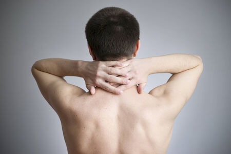 Neck pain in men. Touching the body. photo