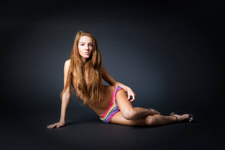 Young naked girl in studio. Beautiful woman with long hair photo