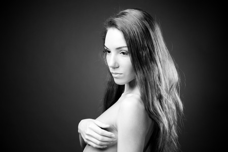 Young naked girl in studio. Hairstyle beautiful woman. Black and white photography photo