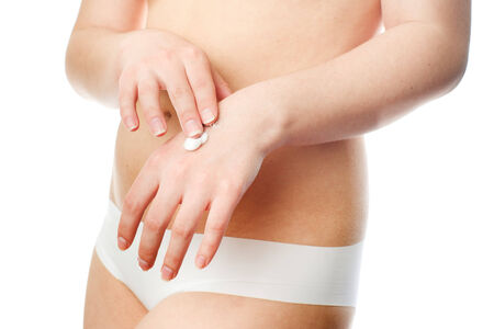 Young womans body on white background. photo