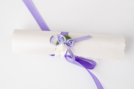 Empty paper scroll on a white background. Wedding invitation\ with flowers