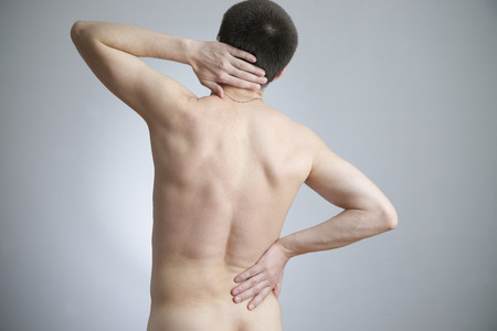 Pain in a body of the man on gray background photo