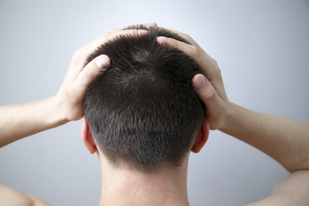 male headache: Headache of the man on gray background. Nape young adult man
