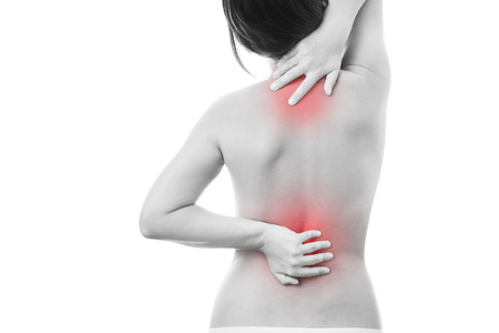 Pain in back of women. Isolated on white background. Caring for the female body. Red dot Stock Photo