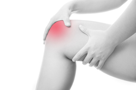 broken knee: Knee pain of the woman.  Isolated on white  Stock Photo