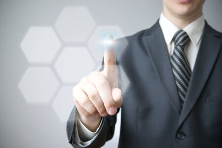 software solution: Business concept. Businessman presses a button on the touch screen.