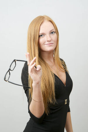 Portrait of business woman on a gray  photo