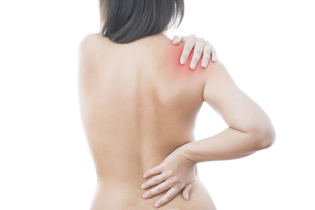 soreness: Hands on a womans shoulder. Pain in the muscles. Stock Photo
