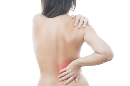 Pain in back of women. Isolated on white background. Caring for the female body. Red dot photo
