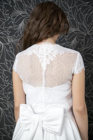 Beautiful woman in white wedding dress.  Back view photo