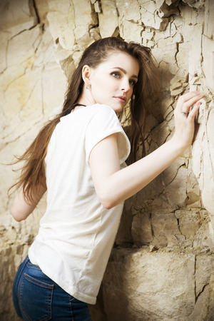 clambering: Portrait of a beautiful young woman climber. Girl climbs a rock Stock Photo