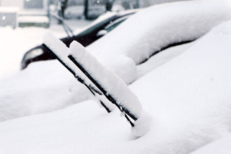 Cars after a snowfall. Windshield wiper raised up. photo