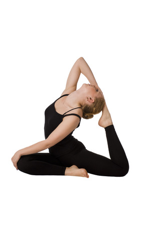 Beautiful slim woman doing yoga. Isolated on white background. Girl meditates in a pose of a pigeon.