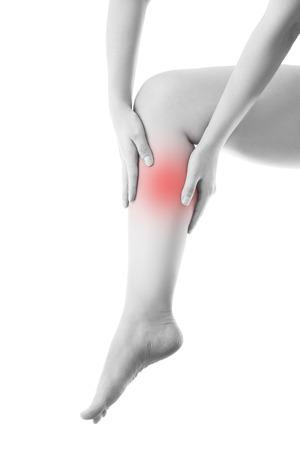 Schmerzen im Bein. Massage der weiblichen Fuß. Isoliert auf weißem Hintergrund.