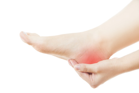 massaged: Pain in the foot. Massage of female feet. Pedicures. Isolated on white .