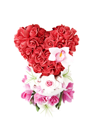 Gift for Valentines day. Flowers in the shape of heart isolated on white background. photo