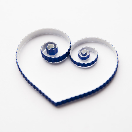quilling: Quilling paper on white cardboard. Background with heart for Valentines day.