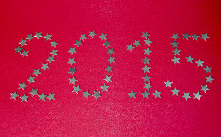 posted: New Year. The numbers posted by asterisks on red background. Stock Photo