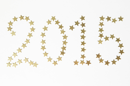 posted: New Year. The numbers posted by asterisks on white background. Stock Photo