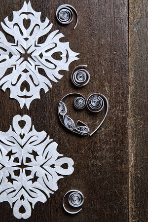 Snowflakes out of paper on wood background. Christmas. New Year. photo