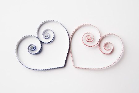 quilling: Quilling paper on white cardboard. Background with hearts for Valentines day.