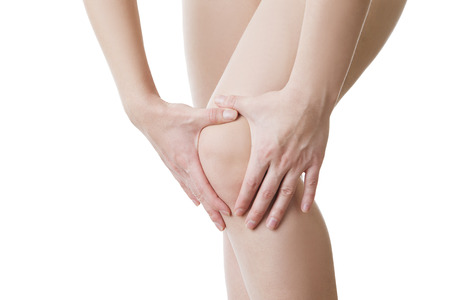 enhanced healthy: Knee pain of the woman.  Isolated on white background. Stock Photo