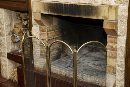 Dirty empty fireplace with firewood. Interior decor. Фото со стока - 35223968