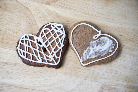 Gingerbread cookies with icing heart shaped. Homemade cakes. Christmas food photo