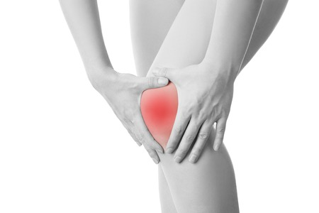 broken knee: Knee pain of the woman isolated on white background.
