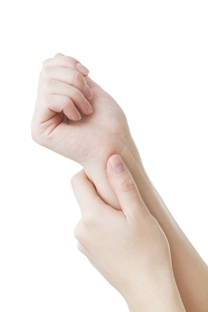 carpal tunnel syndrome: Pain in the joints of the hands. Carpal tunnel syndrome.  Isolated on white background. Care of female hands.