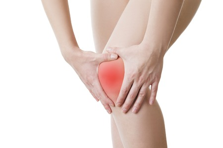 enhanced healthy: Knee pain of the woman isolated on white background.