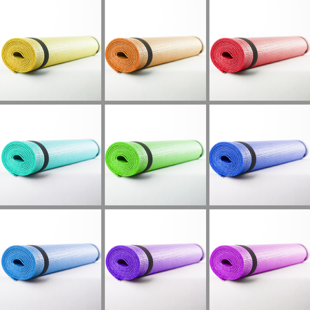Colored mats for fitness on a white background closeup. Collage photo