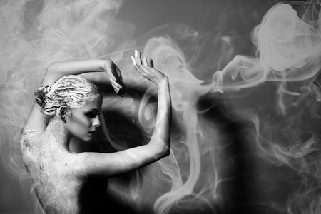 naked girl black hair: Portrait of the beautiful naked woman. Abstract smoke. Black and white photography. Body care. Spa. Mask of clay