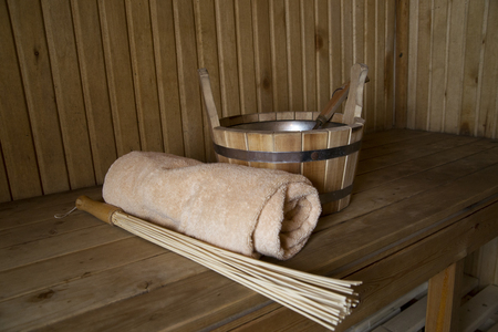 finnish bath: Sauna, bath accessories. Wooden bucket and towel Stock Photo