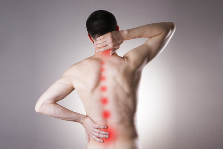Pain in a body of the man on gray background. Red dot Stock Photo