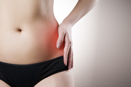 griping: Pain in the left side of the woman. Attack of appendicitis. Red dot. Stock Photo