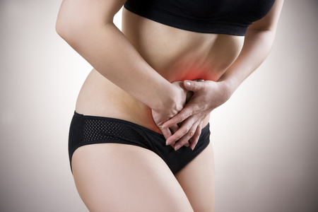 bloating: Abdominal pain, heartburn, bloating on gray background. Red dot