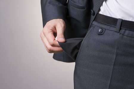 Concept of bankruptcy - empty pocket on a gray background. photo