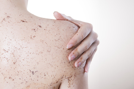 Body care, skin peeling. Massaging the back. Stock Photo