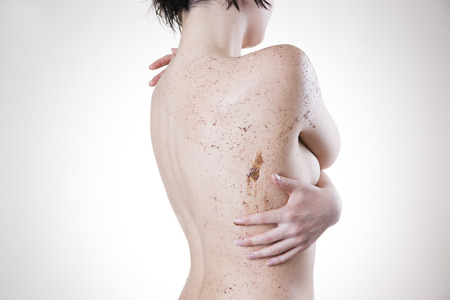 Body care, skin peeling. Massaging the back. Stock Photo