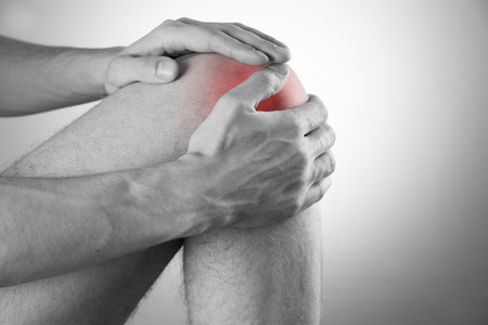 enhanced healthy: Knee pain in men on gray background