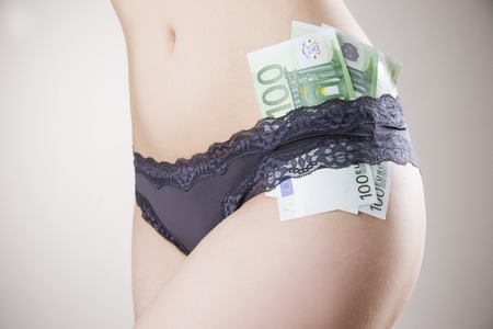 sexy naked girl: Concept - prostitution. Euro banknotes in panties